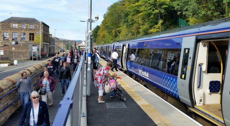 People alighting train at station